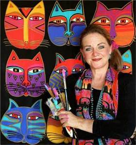 photo of Laurel Burch with paint brushes; cats in background