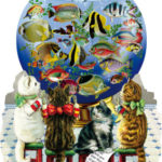 4 cats sitting in front of globe with fish designs
