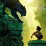 The boy, Mowgli with Bagheera, the black panther