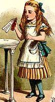 """Alice holding bottle that says """"drink me"""""""