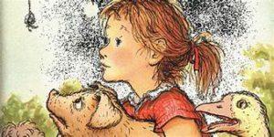 little girl holding pig