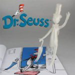 Ad for Dr. Seuss with phantom figure standing on book