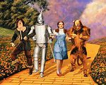 Dorothy, Tin Woodsman, Scarecrow, and lion on yellow brick road