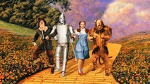 Dorothy, Tin Woodsman, Scarecrow, and lion on yellow brick road
