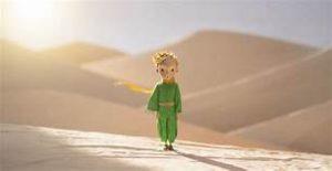 Boy walking in desert