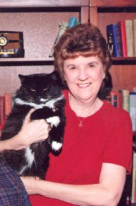 lady in red sweater holding black cat