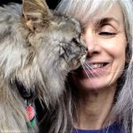 Silver-haired woman with silver-haired cat