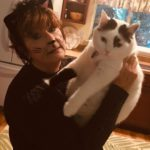 Halloween cat lady and white & black cat