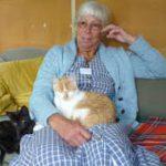 cat sitting on old lady's lap