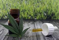 bottle, dropper, and pot leaf