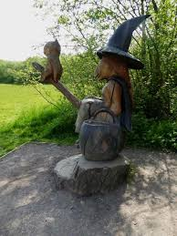 statue of witch, cat, cauldron