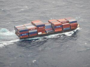 Barge traveling, filled with containers