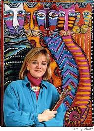 pic of Laurel Burch with artwork in background