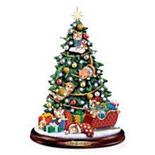 Illuminated Christmas tree; kittens in tree