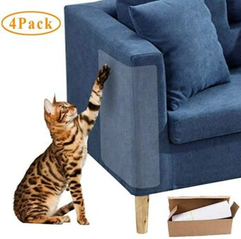 Cat scratching at sofa corner with shield