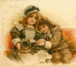 Old-fashioned post card: two little girls, sitting, one with cat on lap