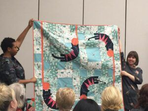 whimsical cats on blue & white quilt