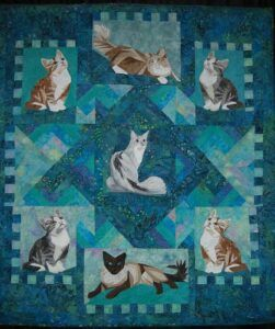 Realistic cat pics in quilt squares, lots of blue