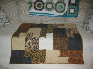 simple cat blocks fitted together on quilt