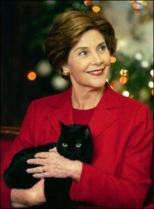 Laura Bush holding India, a black cat