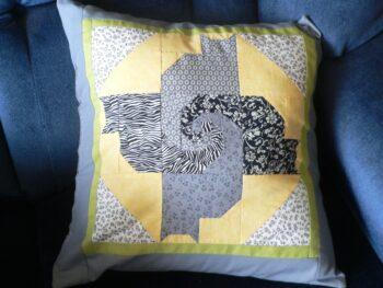 Pillow with four cat design